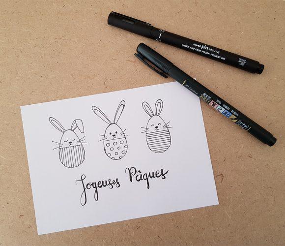 Je dessine ma carte de Pâques.