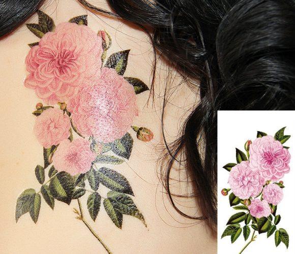 Un tattoo sur moi de rose en fleurs magnifique